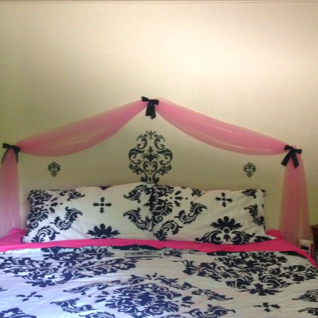 Instead of buying a new headboard take some fabric and drape it above bed and decorate with wall decals