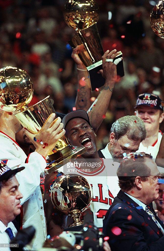 Chicago Bull player Michael Jordan (C) is surround
