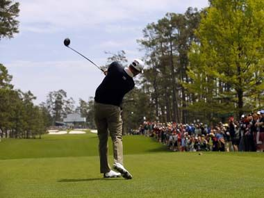 Defending champion Adam Scott drives off the seventh tee during a ...