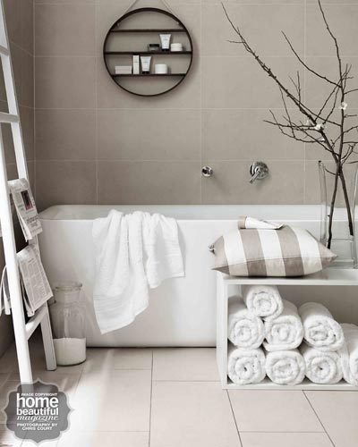 Rolled Towels In Bathroom: Accessories Lift This Simple Bathing Zone; They Include
