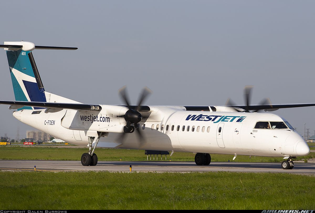 WestJet Bombardier DHC-8-402 Q400 C-FOEN on the taxiway at Toronto-Pearson International, May 2018. (Photo: Galen Burrows)