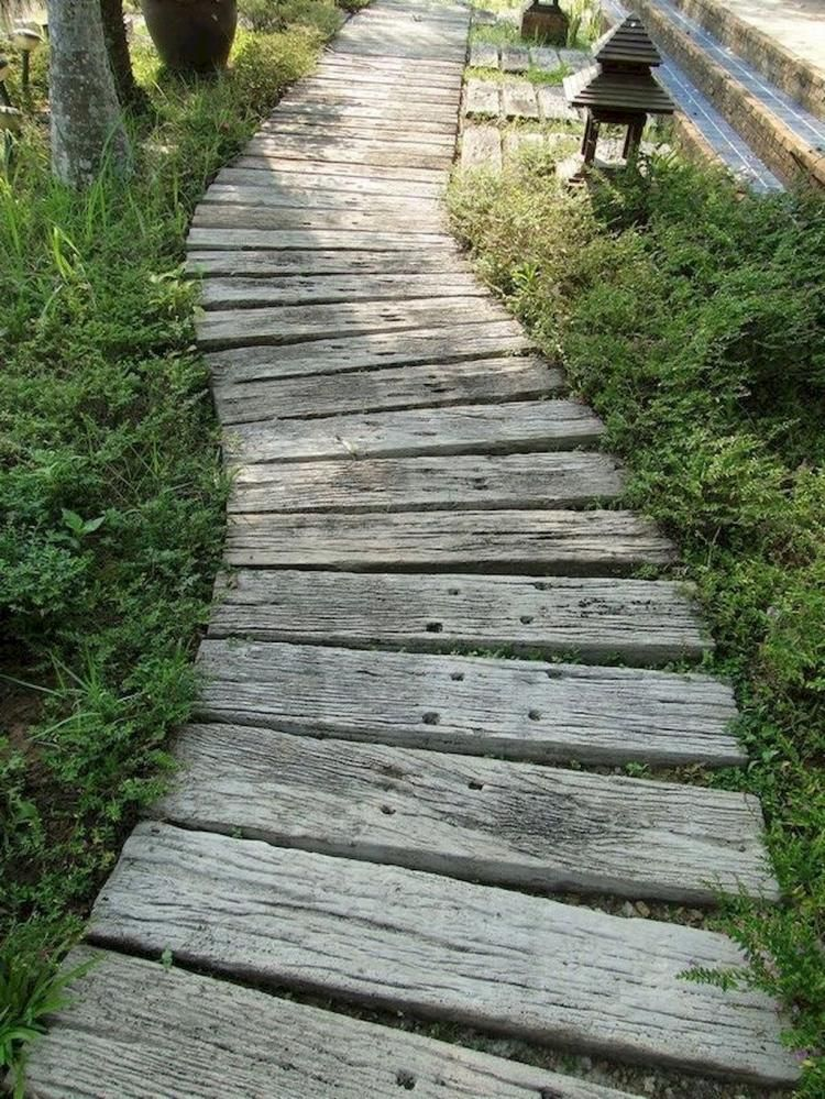 Photo of 30+ Simple and Affordable Wooden Garden Path Ideas #gardenpaths Wooden is known …