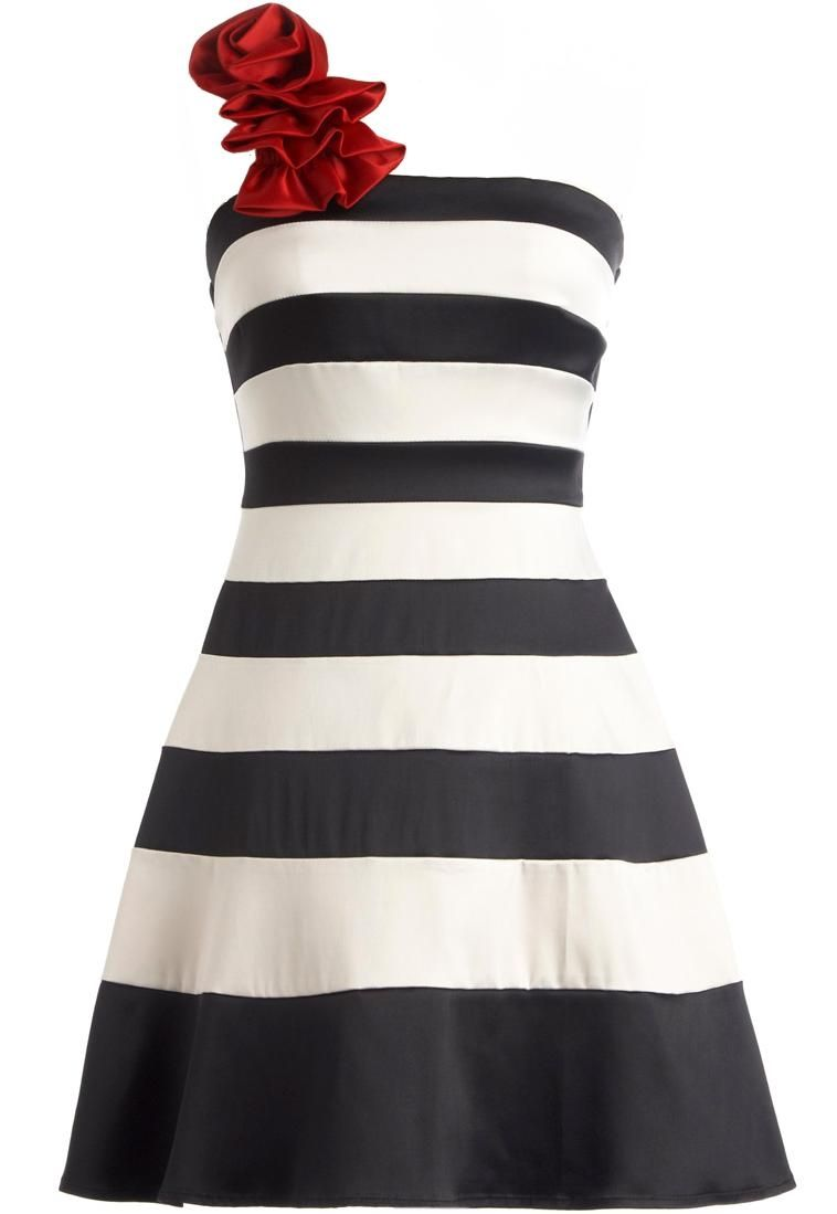 Nautical Nostalgia Dress: Features an elegant one-shoulder design accented with a vibrant crimson rosette, bold black and ivory stripes throughout for a 50s-era flavor, flexible banded back strap for a custom fit, and a dramatic flared A-line silhouette to finish.