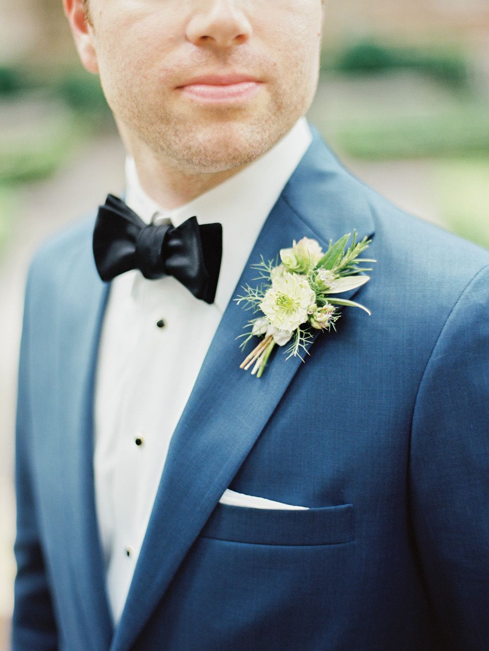 Groom Style: Navy blue suit and bow tie. Boutonniere by Rosegolden ...