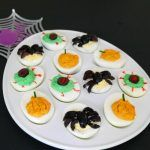 Halloween Deviled Eggs - a low carb classic to serve at a party or as an appetizer! #lowcarb #lowcarbhalloween #ketohalloween #deviledeggs #halloweendeviledeggs