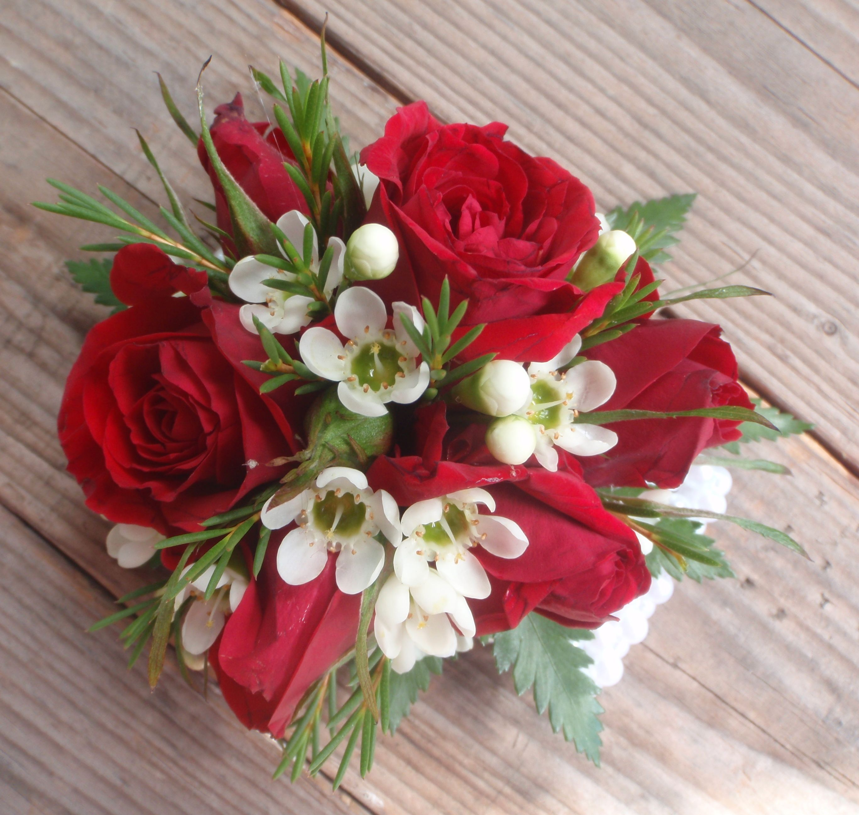 Red Spray Rose and White Waxflower corsage. | Red Weddings ...