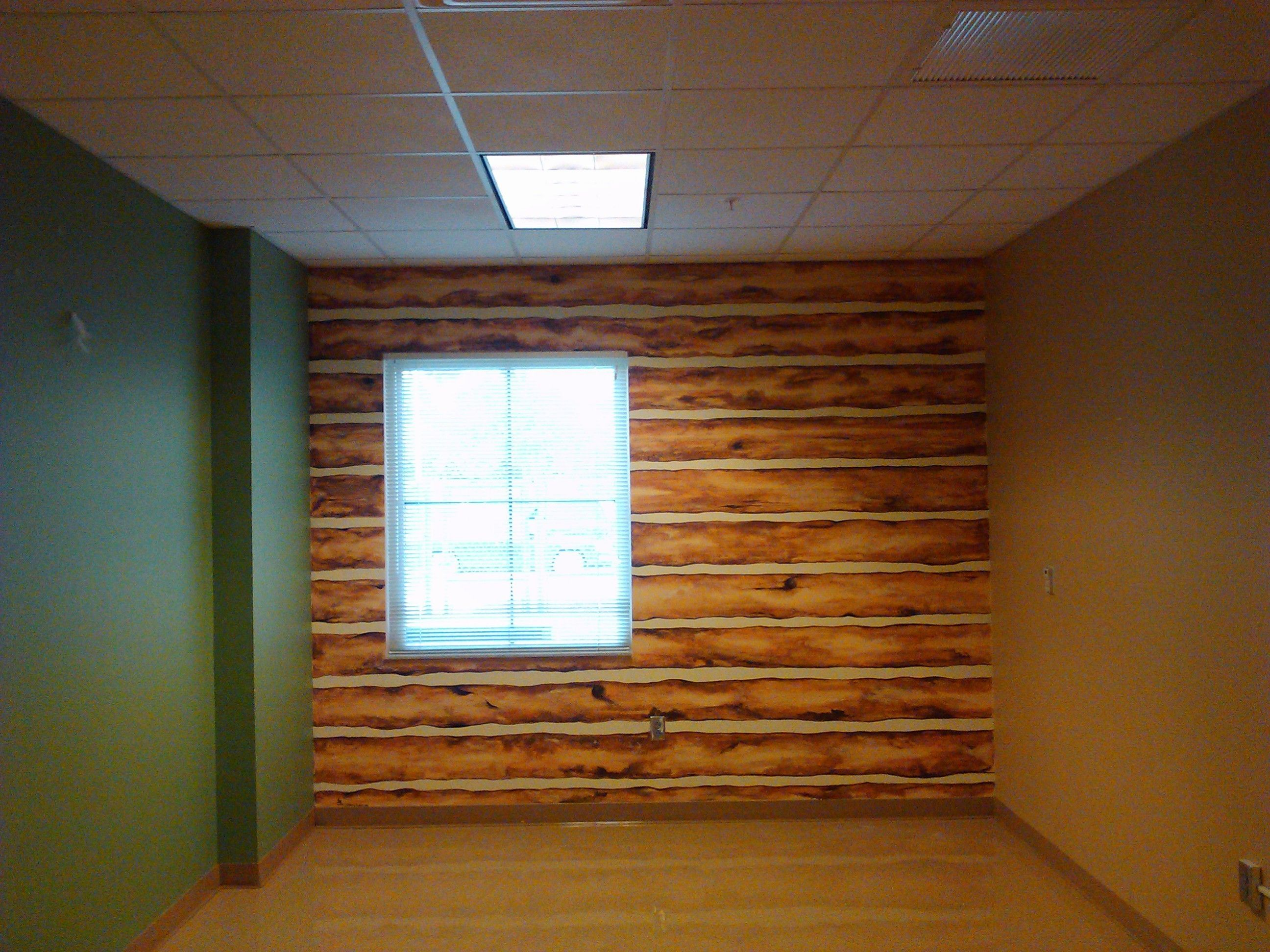 Faux log cabin wall acrylic on base of painted concrete for Log cabin basement ideas