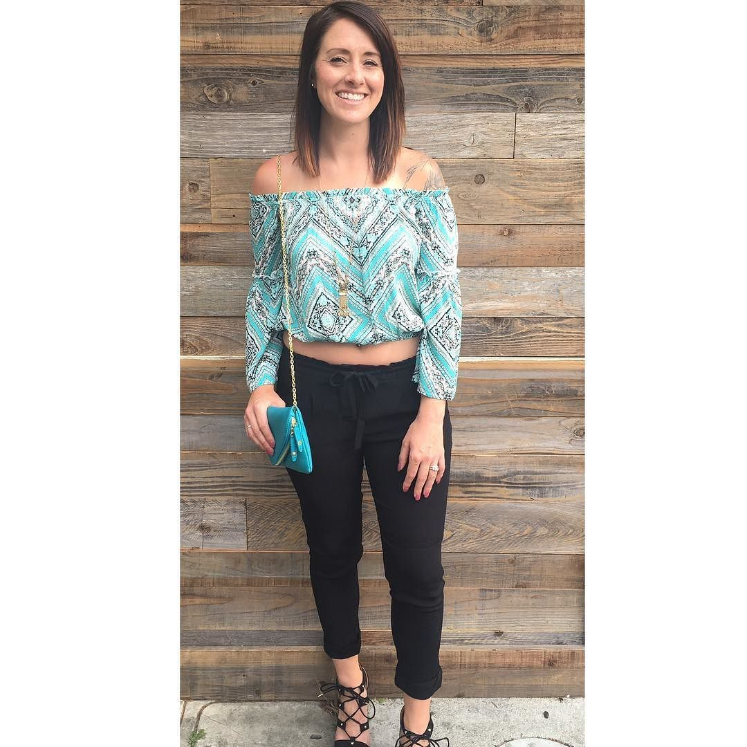 Downtown Campbell: Off the shoulder goodness paired with our cropped black pants lace up wedges and vegan made clutch in teal. #bombshellboutique by bombshellboutiqueca