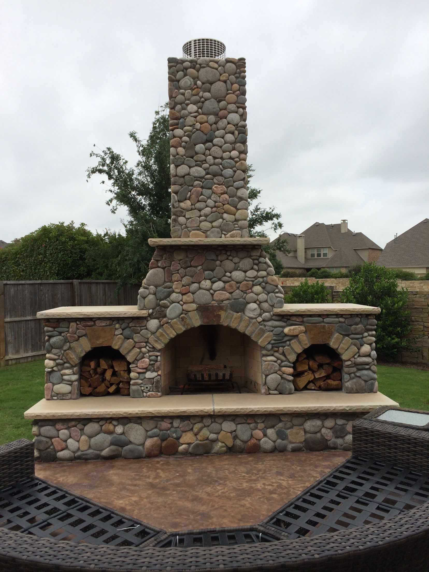 Outdoor Fireplace Built With River Rock Designed And Built By Green Meadows Landscaping Lewisvill Mountain Patio Outdoor Fireplace Outdoor Fireplace Designs