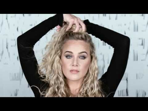 Long curly hair, don't care? Try this effortlessly cool, laid back look. Learn how to create a frizz free half top knot updo. Using Redken Curvaceous, India Batson gives you the step by step tips and (Step Haircut Products)