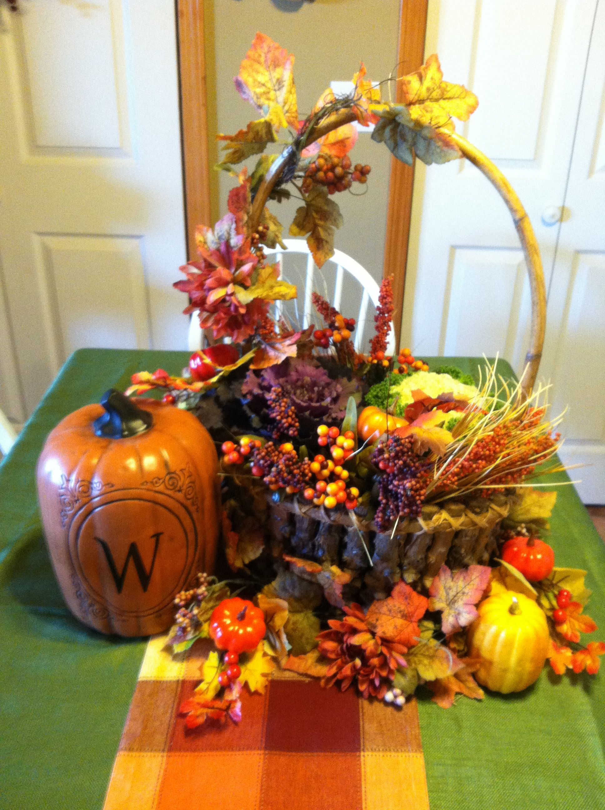 Fall centerpiece with fresh cabbage and kale plants fall