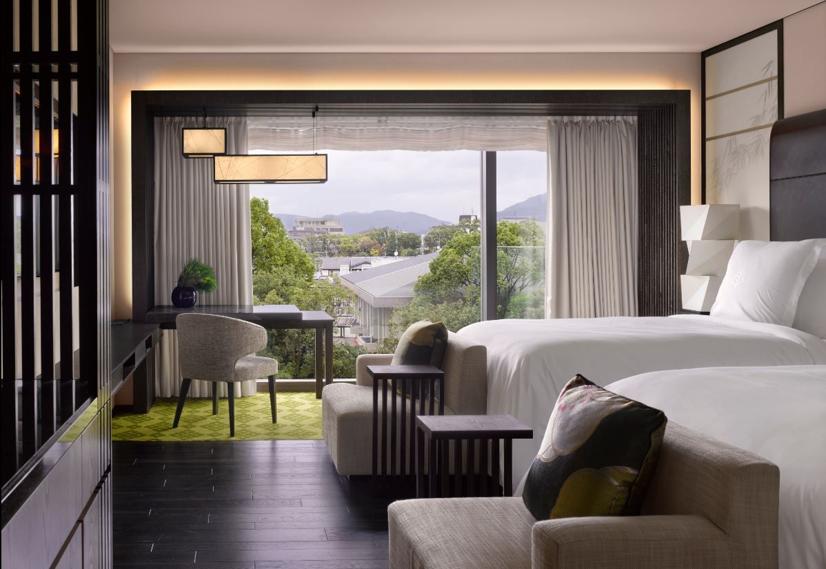 Guestroom with a city view at the four seasons kyoto by for Design hotel kyoto