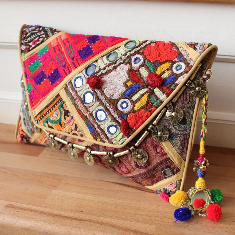 QUEPEM by NAWERI 119€ Boho clutch made from antique embroidered fabrics with a removable strap. Pochette confectionnée à partir de tissus brodés antiques. Chaîne amovible. Modèle unique.