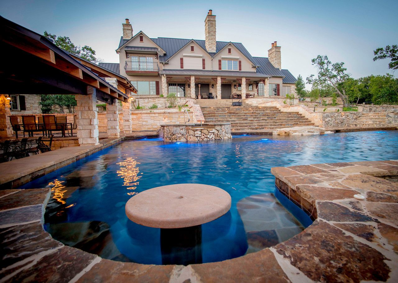 One-of-a-kind pool with swim up bar designed by Cascade Custom Pools ...