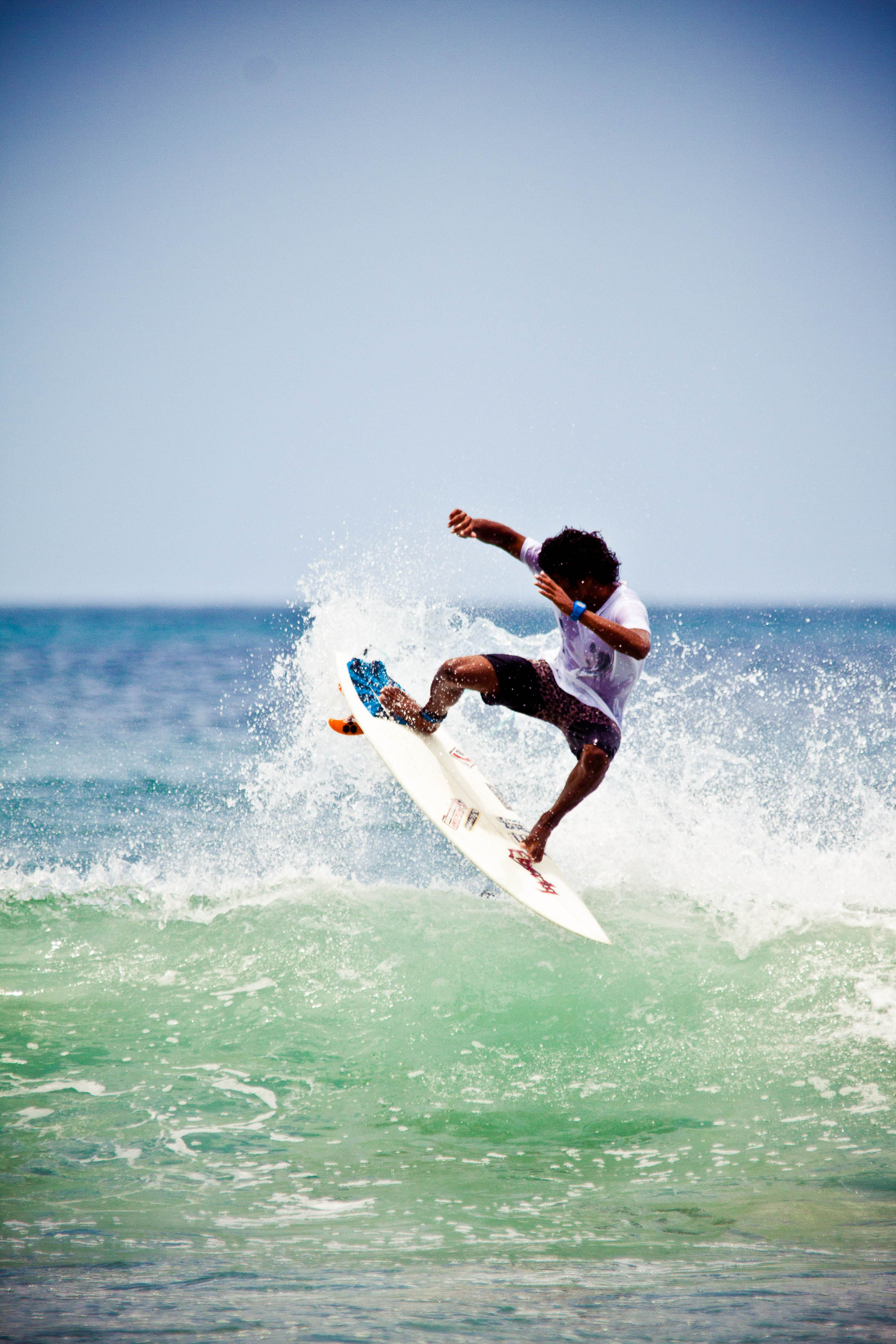 Surfing the waves at Maderas Beach, Nicaragua