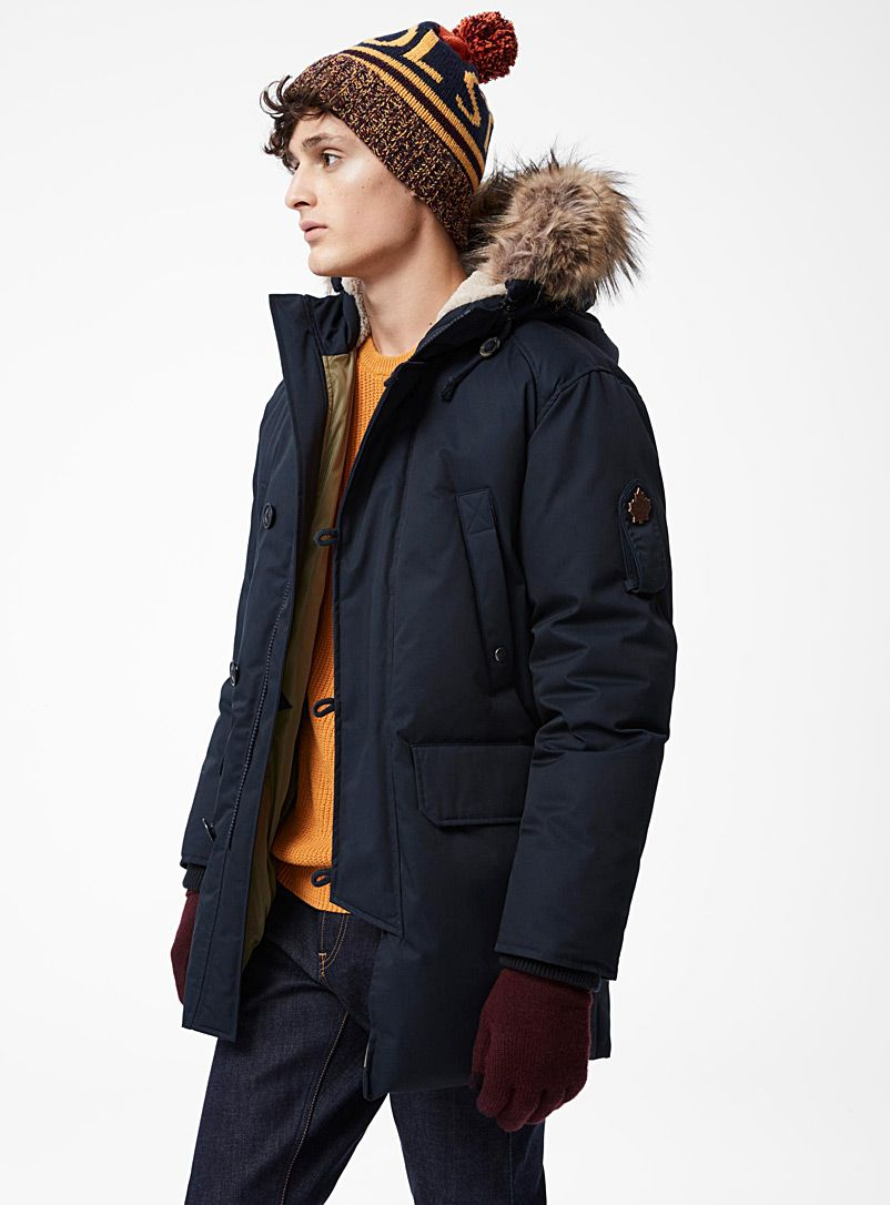 385, Sale 249 as of 2017-01-10 Toboggan Canada at Le 31 for men   An ultra high-performance utility parka for the colder months   Warm down-and-feather insulation   Sherpa-lined storm hood with a removable faux-fur ruff   Two-way zip under a buttoned placket   Recessed rib knit cuffs    The model is wearing size medium