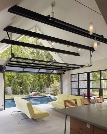 Garage Door Style Windows That Open Up For A Poolside Home Pool House Designs Indoor Outdoor Pool Glass Garage Door