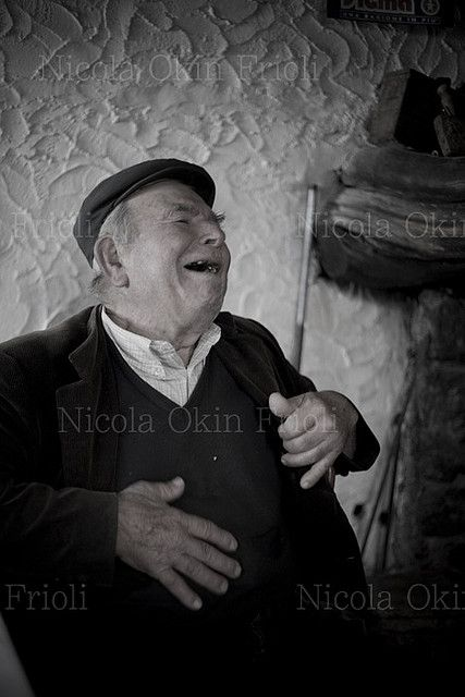 Sardinian Man Laughing whole heatedly