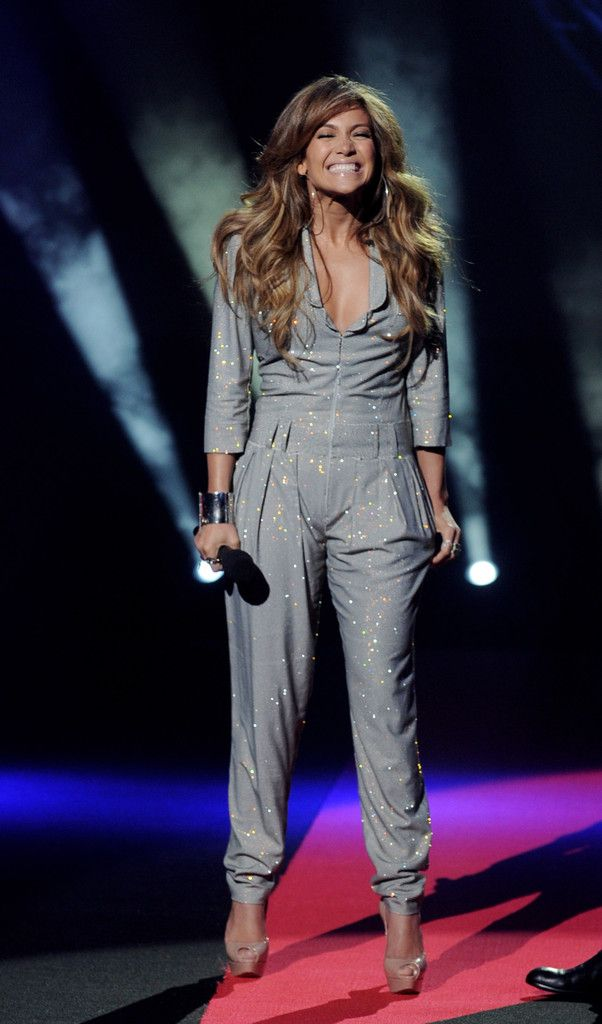 26668b89908b Jennifer Lopez Jumpsuit - Jennifer Lopez showed off her sparkling silver  jumpsuit while making her first appearance at the American Idol show.