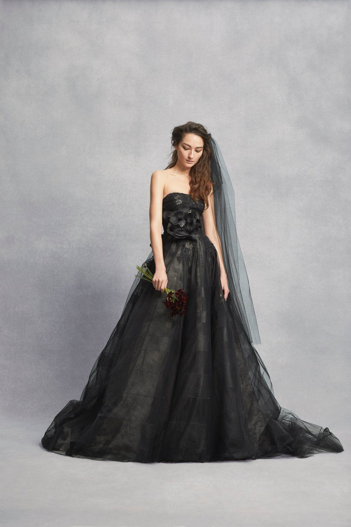 This black lace ballgown by Vera Wang is so unique! Head to David\'s ...