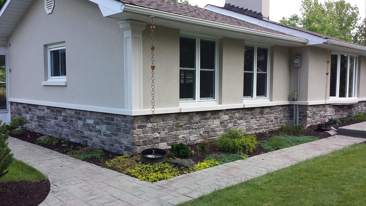 Exterior stucco with stone ranch style ontario exterior for Stucco facade