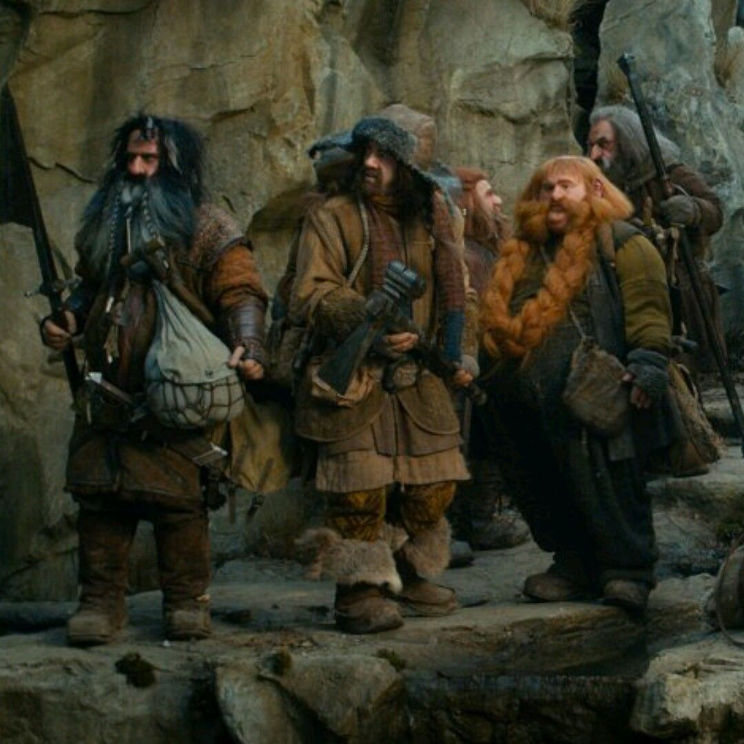 Bifur, Bofur, Bombur, and at least Ori and Oin in the background... possibly Dwalin's back but it might just be a rock. :P