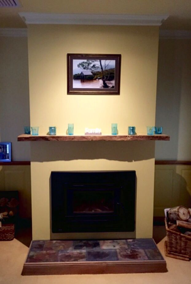Feature fire place with slate base hearth and red gum timber ...