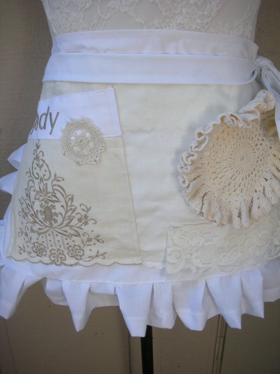 Brides Maids Aprons......Handmade by ME! Placement of vintage linens will vary but yours will be the cutest! The picture of this apron will vary slightly from yours... This pretty lacey aprons has a bit of white...beige....off white.... and crème vintage linens on white kona cotton.... Ive surged all edges and lined this beauty. Ive also added a fab pocket to pick up all those extras that you gather along the way! This beauty comes monogram this beauty comes monogrammed! Measurements: L...