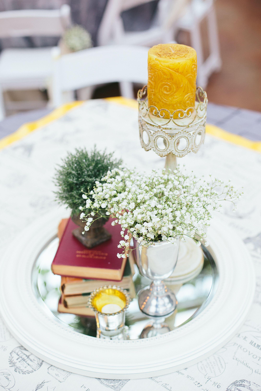 shabby chic wedding centerpiece. cream mirror, old books, flowers in ...