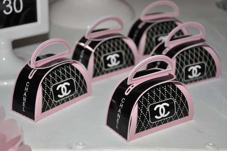 Cute purse favors at a Chanel birthday party! See more party planning ideas at CatchMyParty.com!