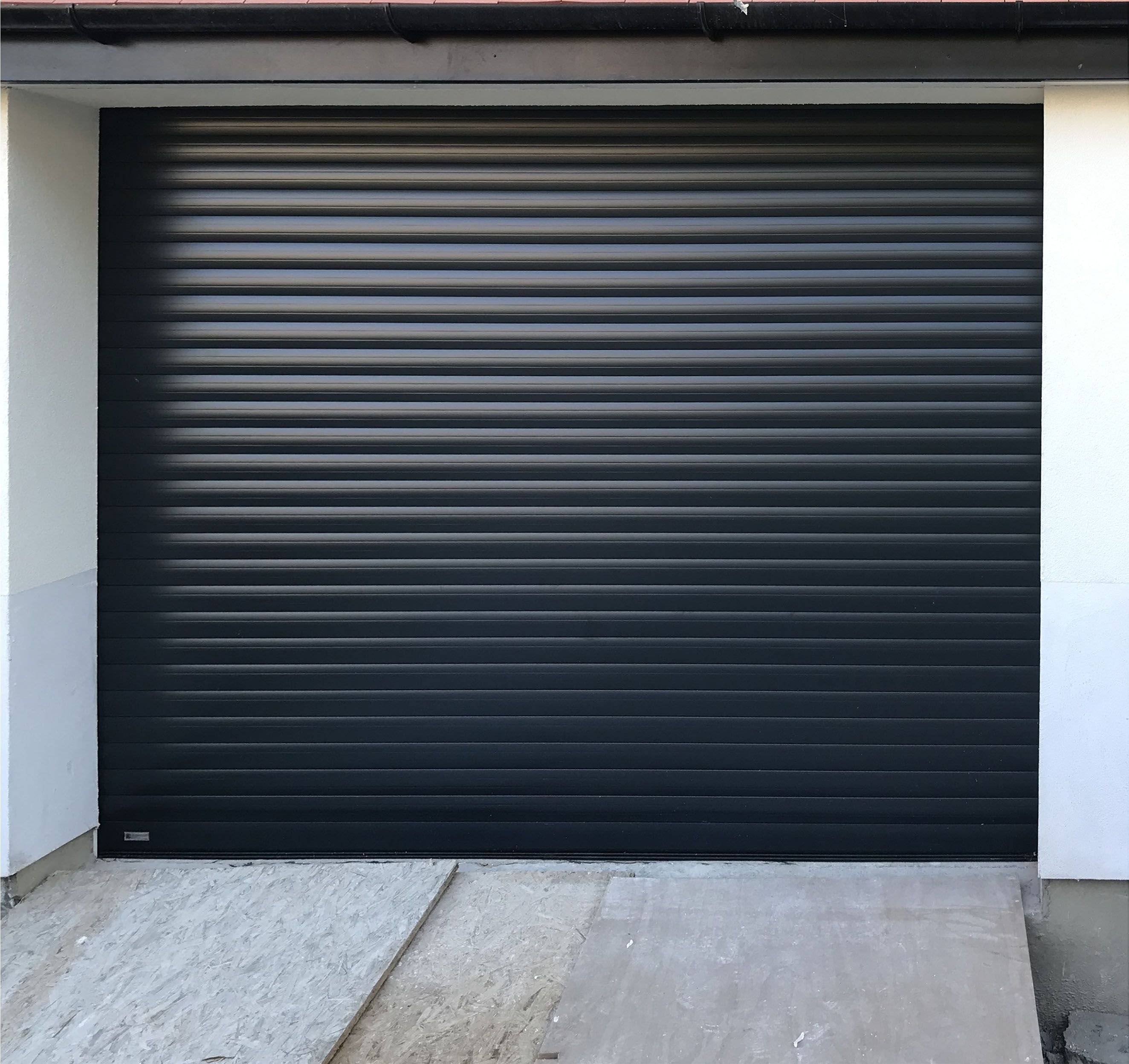 Sws Seceuroglide Excel Roller Garage Door Finished In Black Grey Sectional Garage Doors Garage Doors Black And Grey