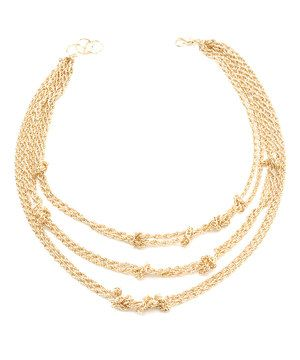 Set a stylish trend with this riveting necklace! Knotted chains and 18-karat gold plating combine for a design worth the wardrobe addition.