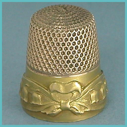 Antique Stern Bros Gold Lily of the Valley Thimble * C1910  $325.00     This pretty 10 Karet gold thimble has a raised design of a bow, ribbons and lilies of the valley applied