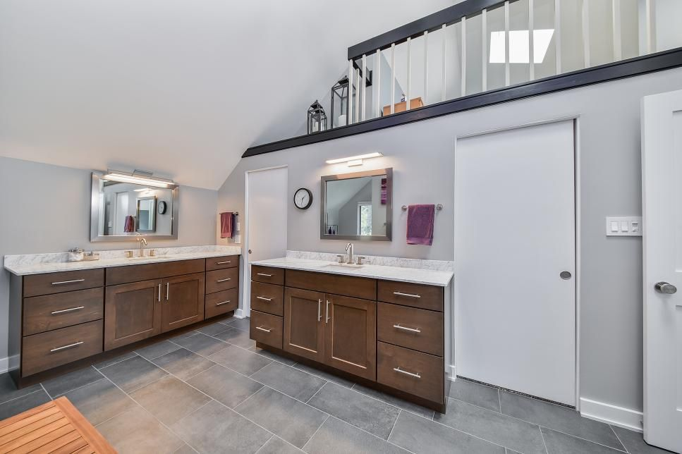 His And Her Vanities With Ample Cabinet And Drawer Space Keep This