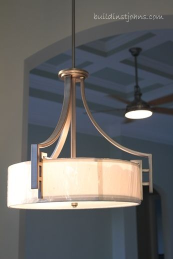 Industrial Light Fixtures Make A Statement In Hunters Creek Model Home Industrial Light Fixtures Light Fixtures Light