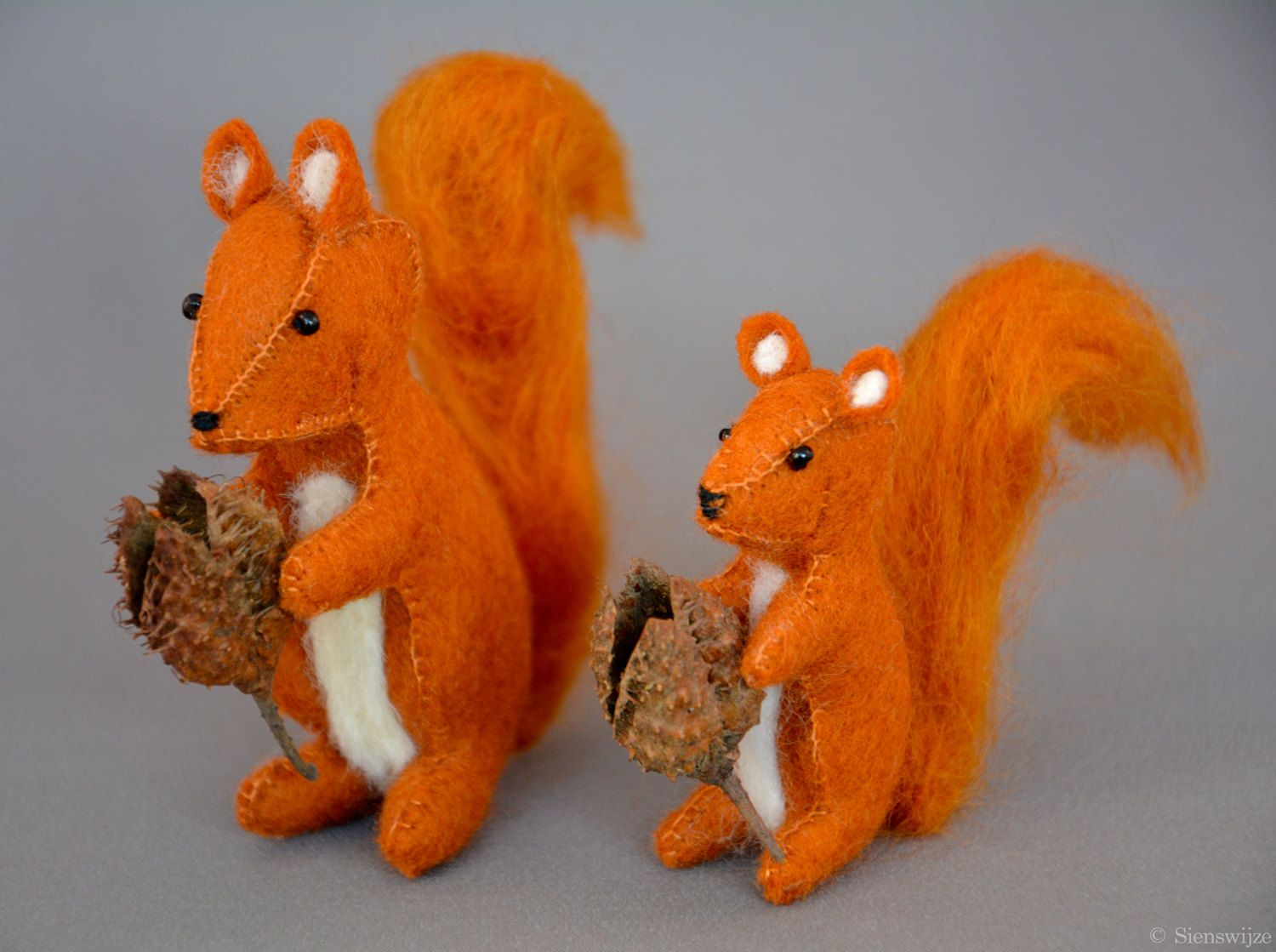 Two lovely little squirrels for on the nature table   #woolfelt #felt #wool #handmade #waldorf #crafted #naturetable #seasontable #autumn #forest #beechnut #squirrel