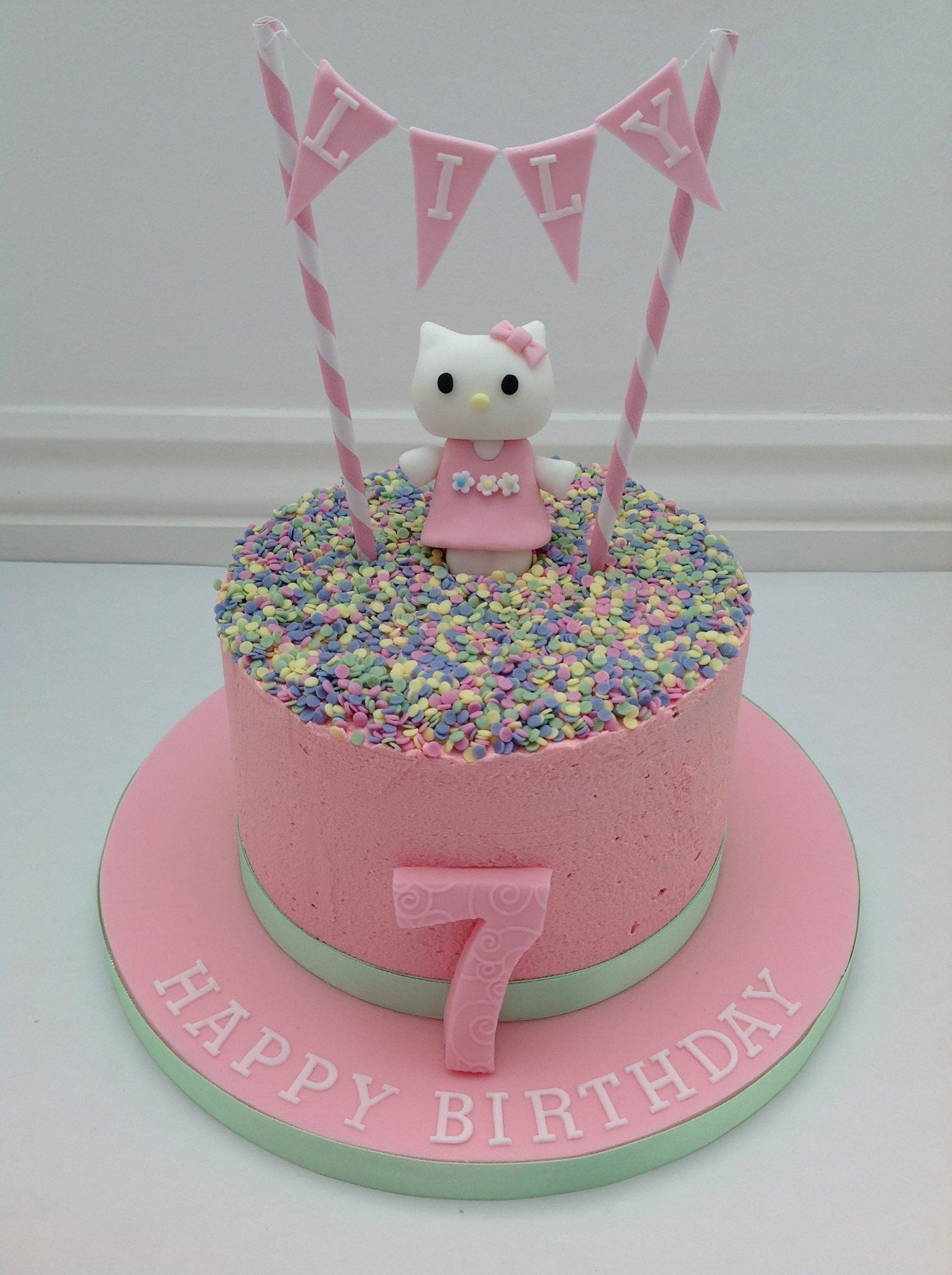 A Hello Kitty Buttercream Cake with Bunting by Fancy Fondant cake