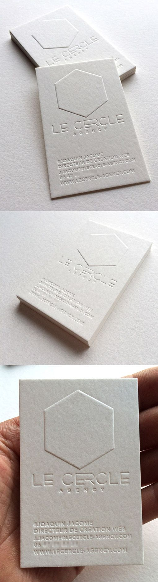 pure white embossed minimalist letterpress business card for a