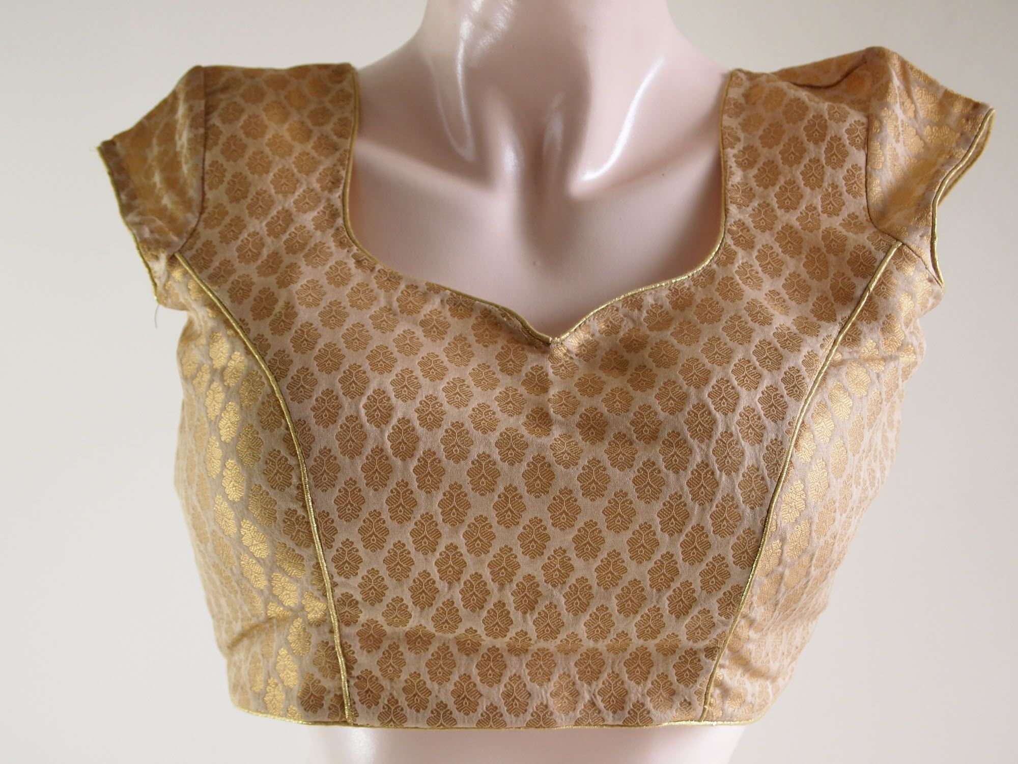 Beige golden brocade blouse blouse designs blouse designs for sarees - Offwhite Gold Brocade Designer Blouse Is A Versatile Padded Brocade Blouse Which Can Be