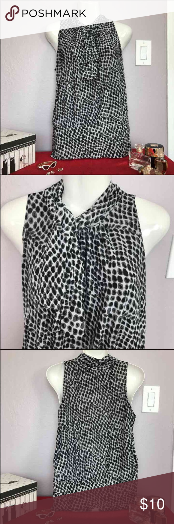 Black and white sleeveless top Has a 'built-in' scarf. Goes great with a pair of white pants and black or red pumps. Tops Blouses