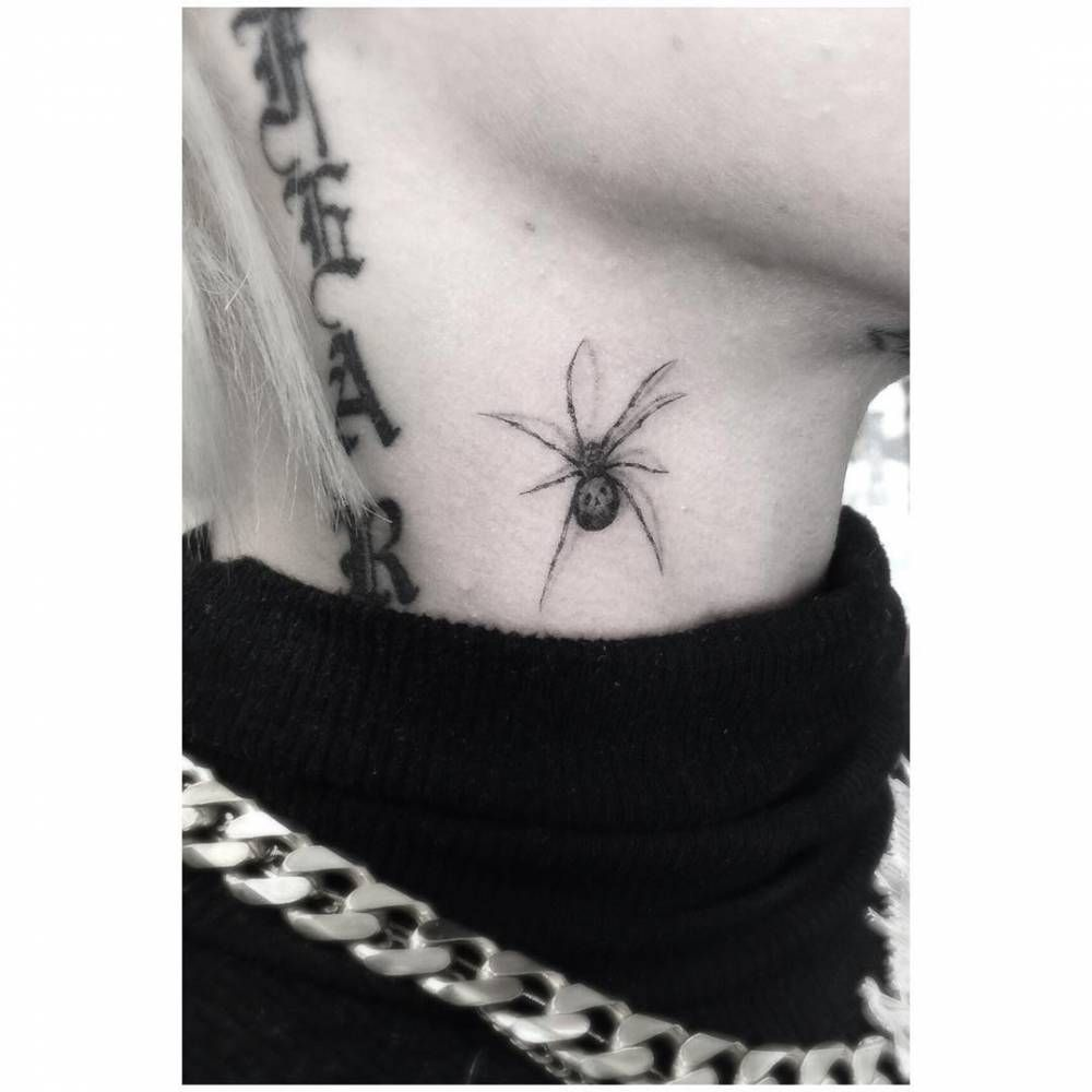 Fine line spider tattoo on brooke candys right side of