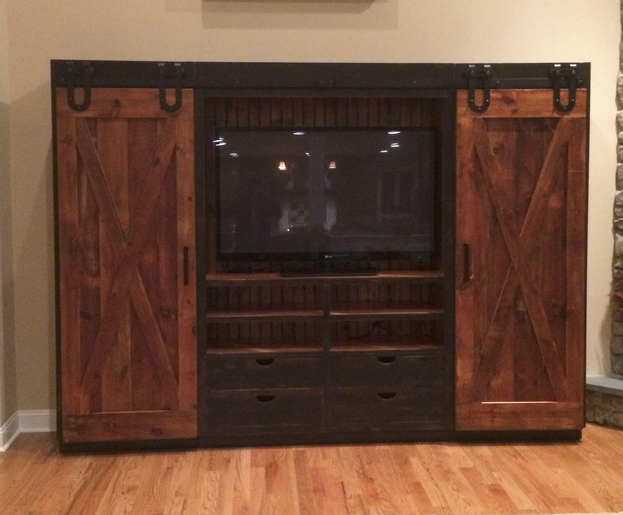 reclaimed barn wood entertainment cabinet with sliding barn doors. Black Bedroom Furniture Sets. Home Design Ideas