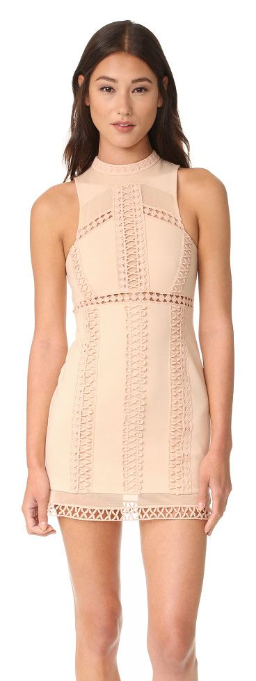 Sky scraper bodycon mini dress by Free People. A formfitting Free People mini dress, detailed with bands of crocheted lace. Sheer mesh reveals a veiled peek of skin...