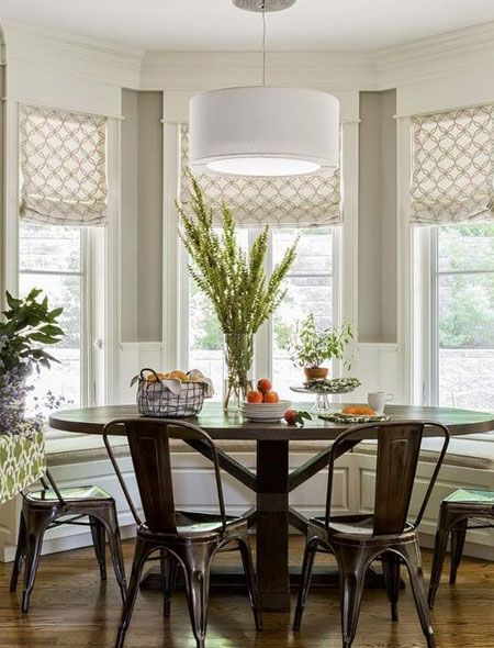 Seating Built Into A Bay Window Is The Ideal Place To Dress Up The Space As A Casual Dinin Round Dinning Room Table Breakfast Nook Curtains Dining Room Windows