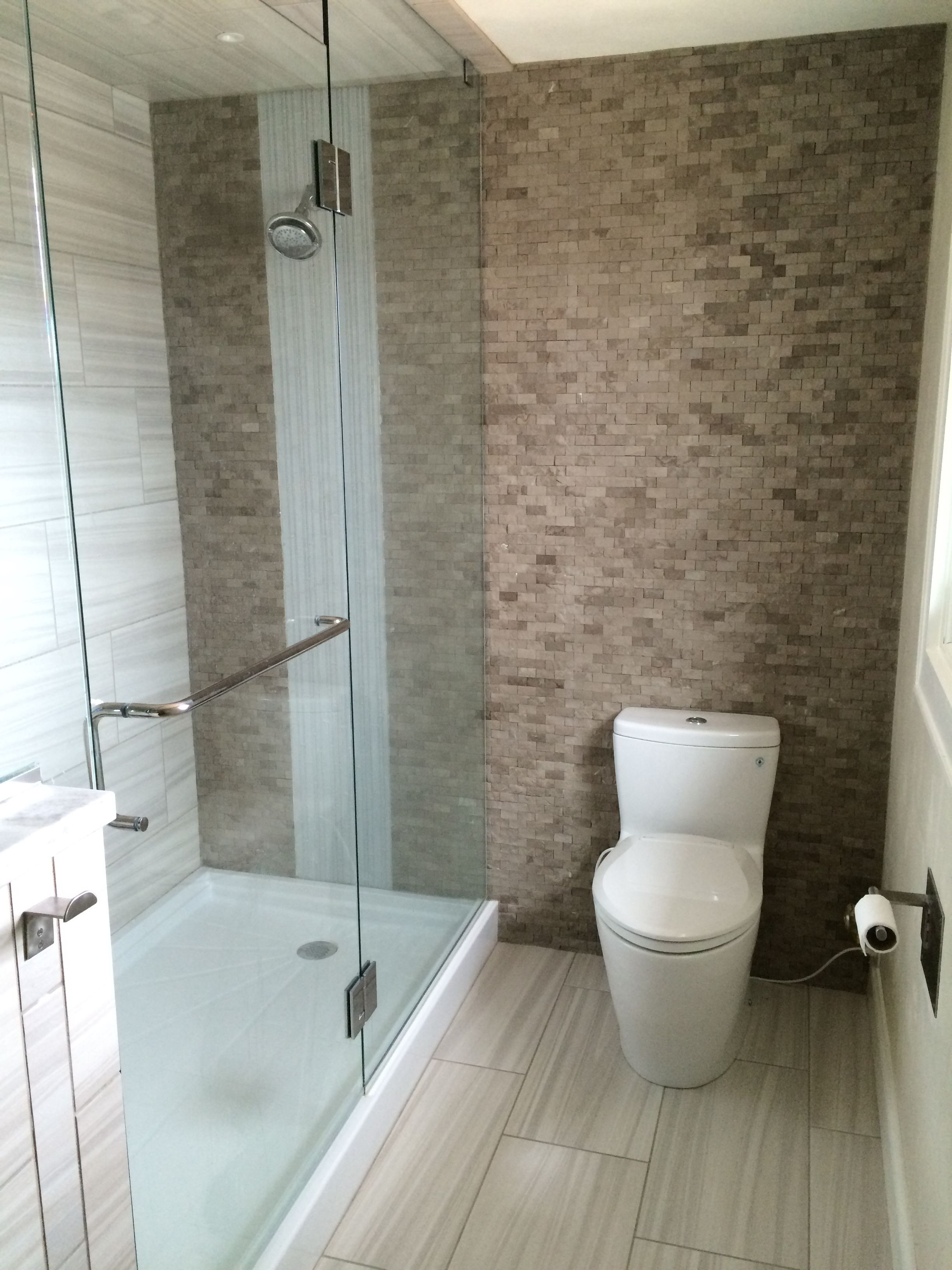 glass shower with a solid acrylic base pan split face slate glass shower with a solid acrylic base pan split face slate accent wall with