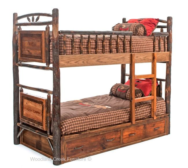 A Rustic Bunk Bed With Drawers Made From Natural Hickory Logs And