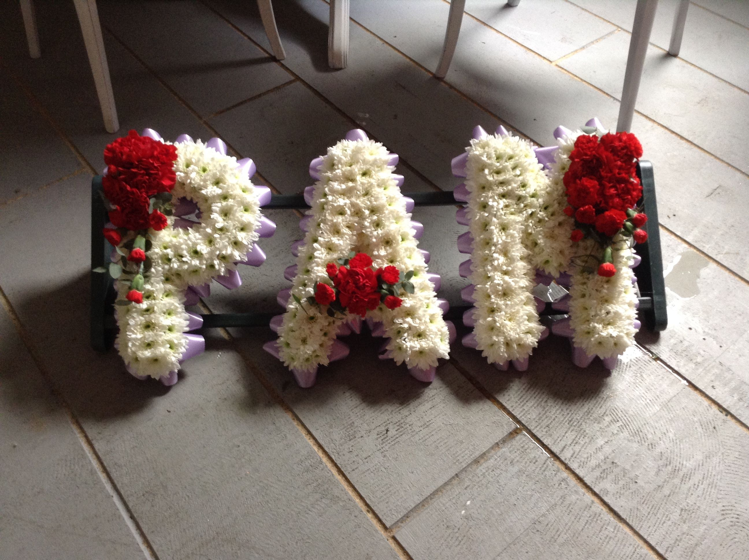 Funeral flower letter tribute lilac and white with a hint of red funeral flower letter tribute lilac and white with a hint of red roses www izmirmasajfo