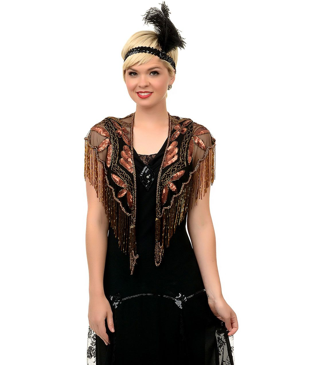 This is a deco-inspired black net and copper beaded capelet that can spruce up just about any outfit for a night out on the town. All hand sewn, the pattern is intricate with gorgeous beaded fringe.