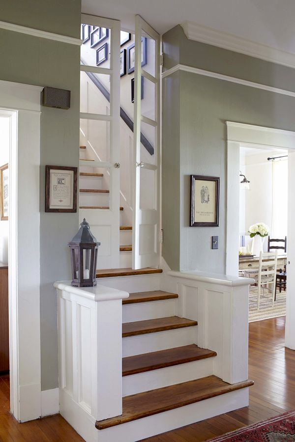 Stairway Treatment With Pony Walls And Double Door With Glass Panes