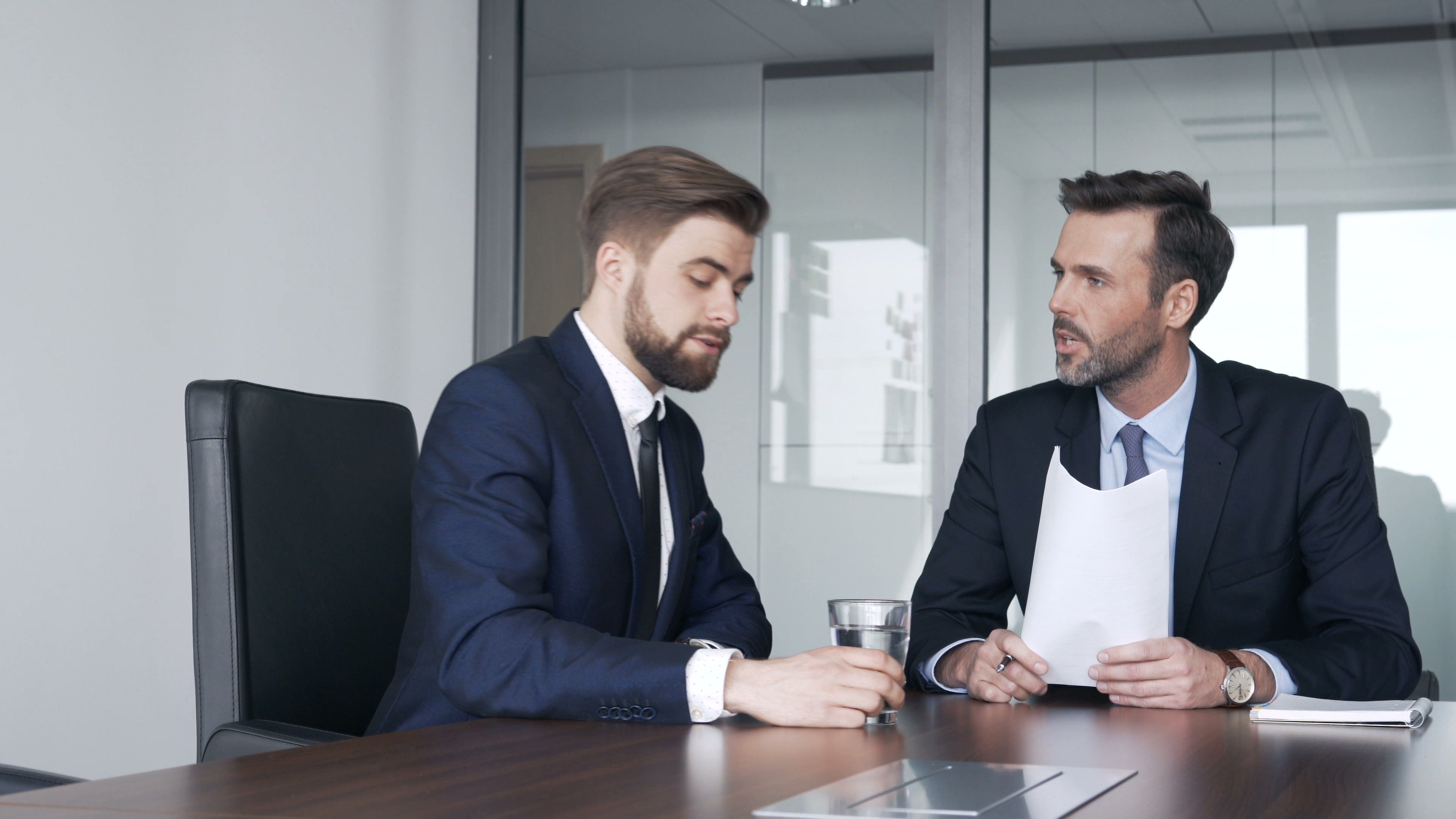 Two Businessmen Talking During Business Meeting At Corporate